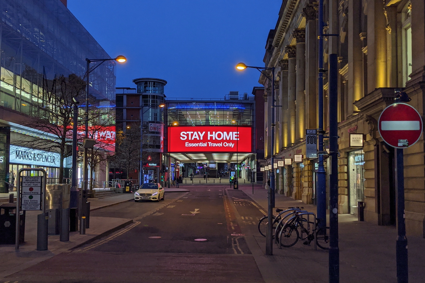 Sign in Manchester city centre displaying 'Stay Home'